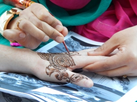 Henna artists lined Coney Island Avenue in Brooklyn's Little Pakistan for the Chand Raat Bazaar, which marks the end of Ramadan.