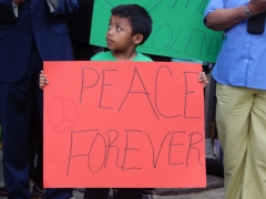 A young resident in Ditmas Park, Brooklyn calls for peace at an intersection where a man was shot and killed.