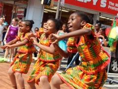 Dancers entertain a crowd in Flatbush, Brooklyn.