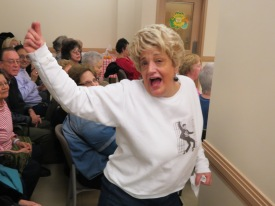 A woman danced to the sounds of an Elvis impersonator at a senior center in Howard Beach, Queens.