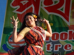 A performer entertains a jubilant crowd at the Potho Mela, one of the largest Bangladeshi celebrations in New York City.