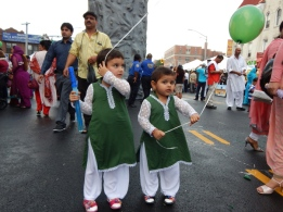 Two of the youngest revelers at the Brooklyn Mela, which celebrates Pakistan's Independence Day in the United States' largest Pakistani community.