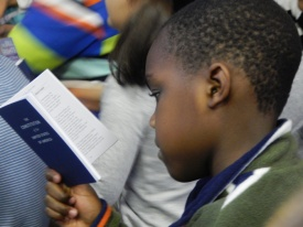 A student at PS 139 in Ditmas Park, Brooklyn reads the Constitution during a lesson on the Bill of Rights.